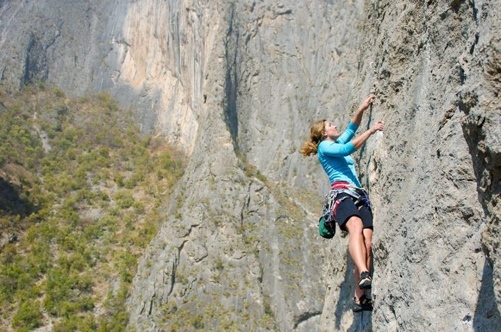 female mom rock climbing mountain climbing mount everest determination analogy